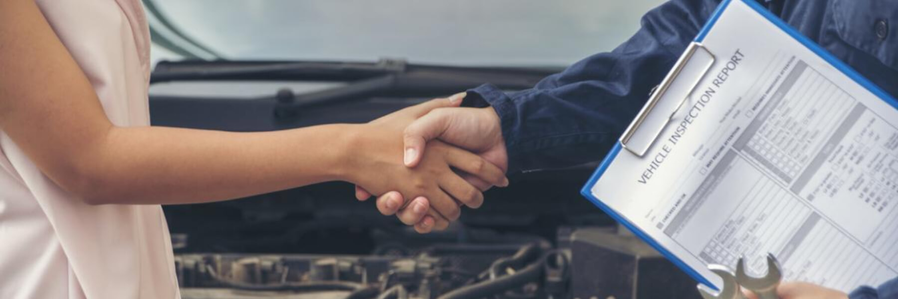 car owner and technician shaking hands