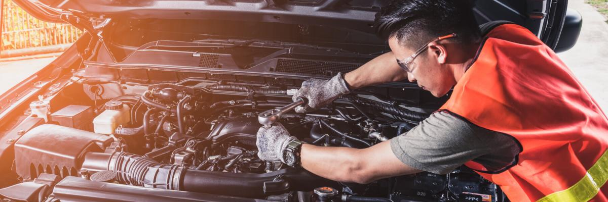 technician repairing or modify the car's engine in the garage. the concept of automotive, repairing, mechanical, vehicle and technology.